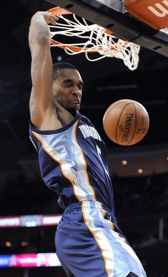 Photo - Memphis Grizzlies' Courtney Lee dunks the ball against the Houston Rockets during the first half of an NBA basketball game Friday, Jan. 24, 2014, in Houston. (AP Photo/Pat Sullivan)