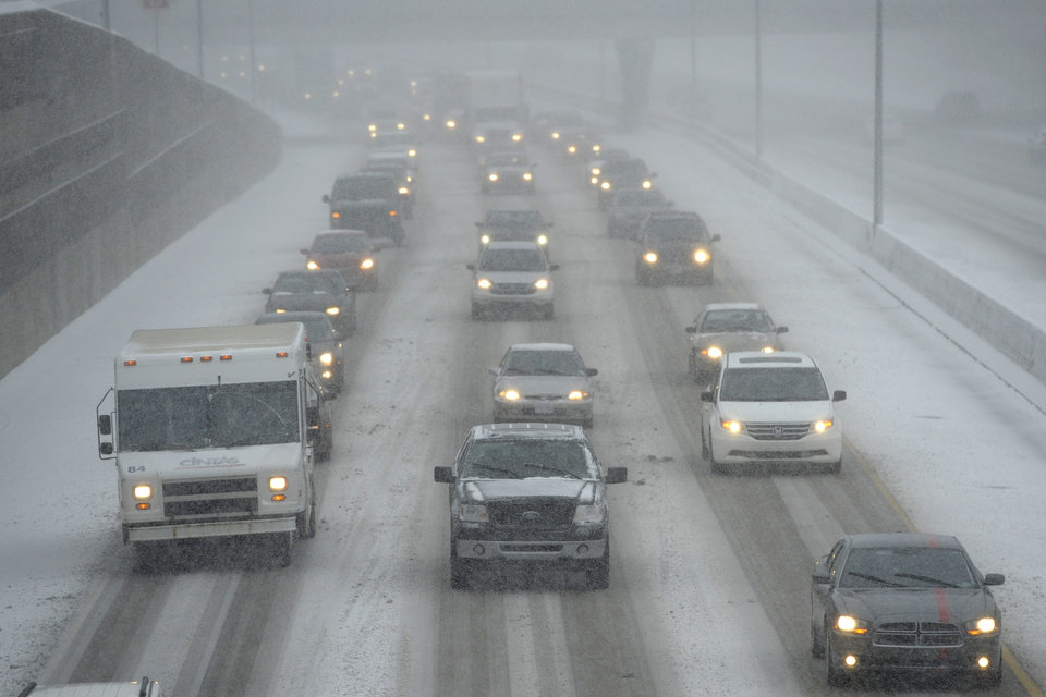 Photo - Cars make their way slowly on the eastbound lanes of Interstate 696 near Central Park Boulevard in Southfield, Mich., Wednesday afternoon, Dec. 26, 2012  (AP Photo/The Detroit News, David Guralnick)