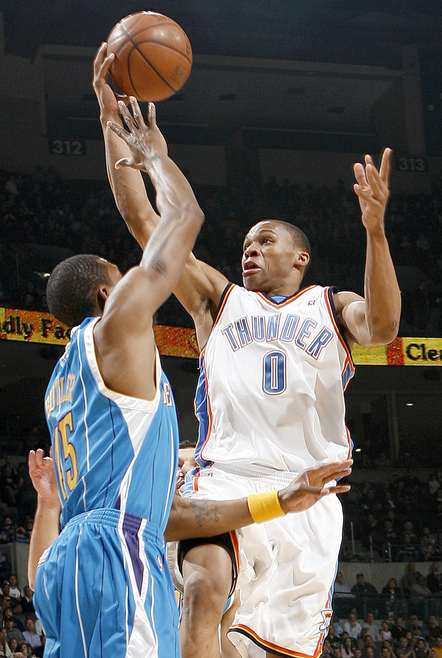 Photo - Oklahoma City's Russell Westbrook shoots over Rasual Butler of the Hornets during the NBA basketball game between the New Orleans Hornets and the Oklahoma City Thunder at the Ford Center,Tuesday, Feb. 17, 2009. PHOTO BY BRYAN TERRY, THE OKLAHOMAN ORG XMIT: KOD