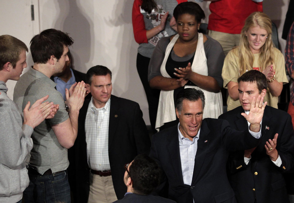 """Photo -   FILE - In this April 27, 2012, file photo Republican presidential candidate, former Massachusetts Gov. Mitt Romney waves after speaking at Otterbein University in Westerville, Ohio. """"I'm absolutely convinced that this nation is the greatest nation on earth, and it is so because of the American people, a people who stand united when called upon by leaders to be united,"""" Romney said, offering unusually measured remarks, even for the former businessman's standards, mentioning Obama by name only a handful of times. """"I will try and unite the American people, not divide us."""" (AP Photo/Jae C. Hong, File)"""