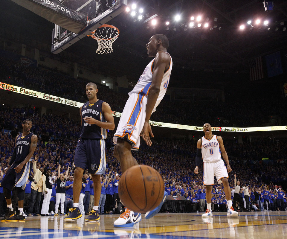 Photo - Oklahoma City's Kevin Durant (35) and Russell Westbrook (0) react after a dunks near Mike Conley (11) and Shane Battier (31) of Memphis in the fourth quarter during game 7 of the NBA basketball Western Conference semifinals between the Memphis Grizzlies and the Oklahoma City Thunder at the OKC Arena in Oklahoma City, Sunday, May 15, 2011. Photo by Sarah Phipps, The Oklahoman