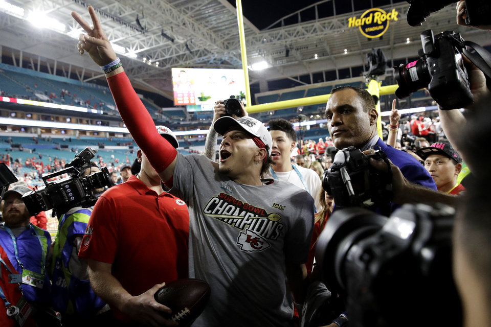 Photo - Kansas City Chiefs quarterback Patrick Mahomes (15) speaks with fans after the NFL Super Bowl 54 football game against the San Francisco 49ers, Sunday, Feb. 2, 2020, in Miami Gardens, Fla. The Kansas City Chiefs won 31-20. (AP Photo/Patrick Semansky)