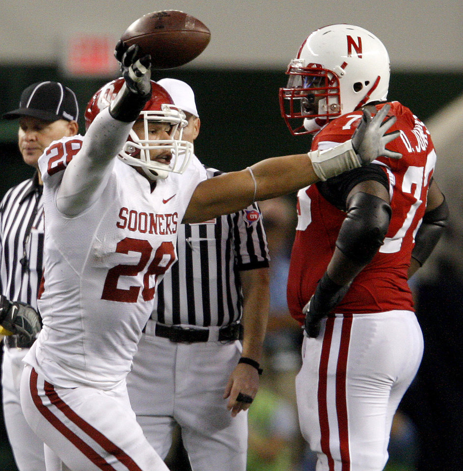 OU's Travis Lewis celebrates in front of Nebraska's D.J. Jones after a fumble recovery during the Big 12 football championship game between the University of Oklahoma Sooners (OU) and the University of Nebraska Cornhuskers (NU) at Cowboys Stadium on Saturday, Dec. 4, 2010, in Arlington, Texas.  Photo by Bryan Terry, The Oklahoman