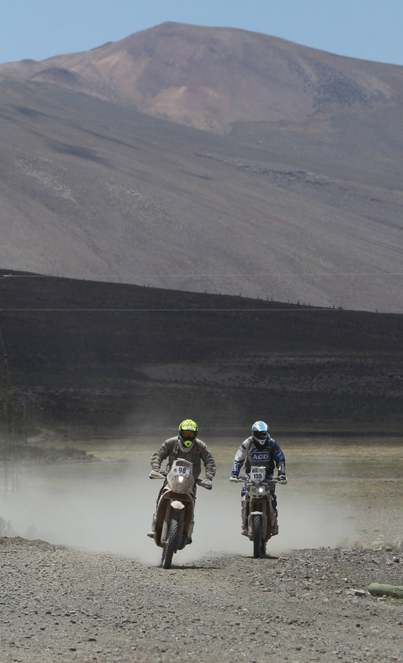 Photo - KTM rider Stephane Hamard of France, left, and Yamaha rider Sebastian Alberto Urquia of Argentina race during the eighth stage of the Dakar Rally between the cities Uyuni, Bolivia and Calama, Chile in Kui, Bolivia, Monday, Jan. 13, 2014. (AP Photo/Juan Karita)