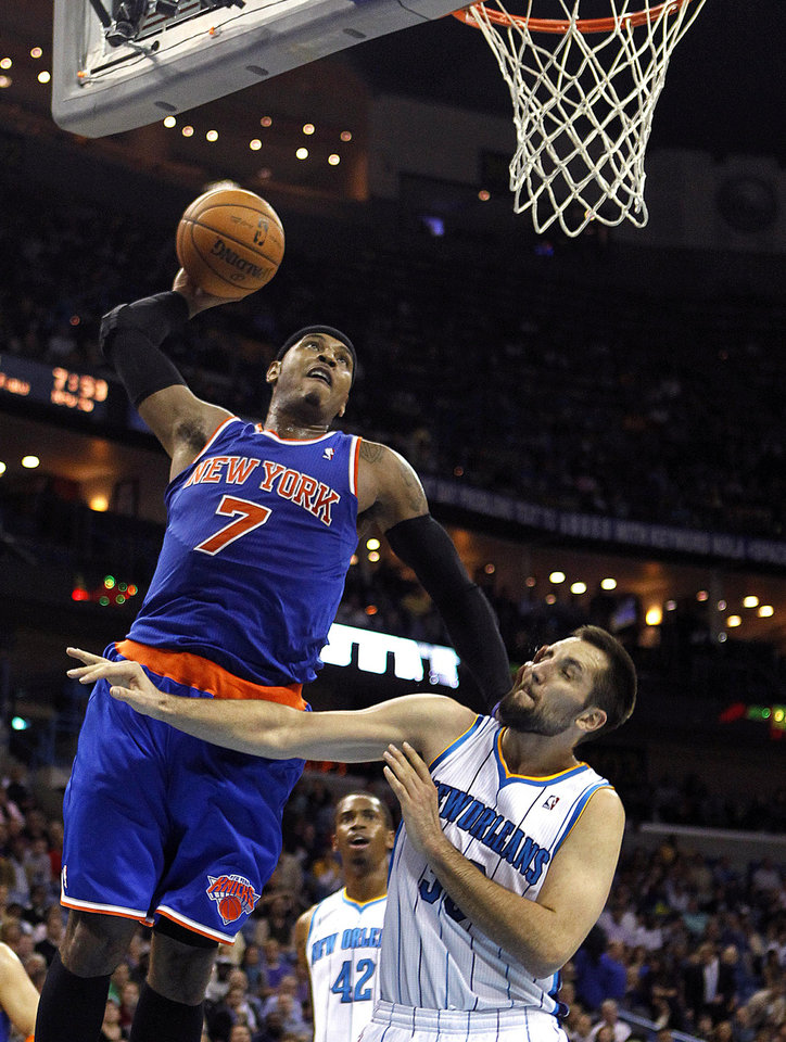 New York Knicks forward Carmelo Anthony (7) goes up for a dunk over New Orleans Hornets forward Ryan Anderson in the first half of an NBA basketball game in New Orleans, Tuesday, Nov. 20, 2012. (AP Photo/Gerald Herbert)