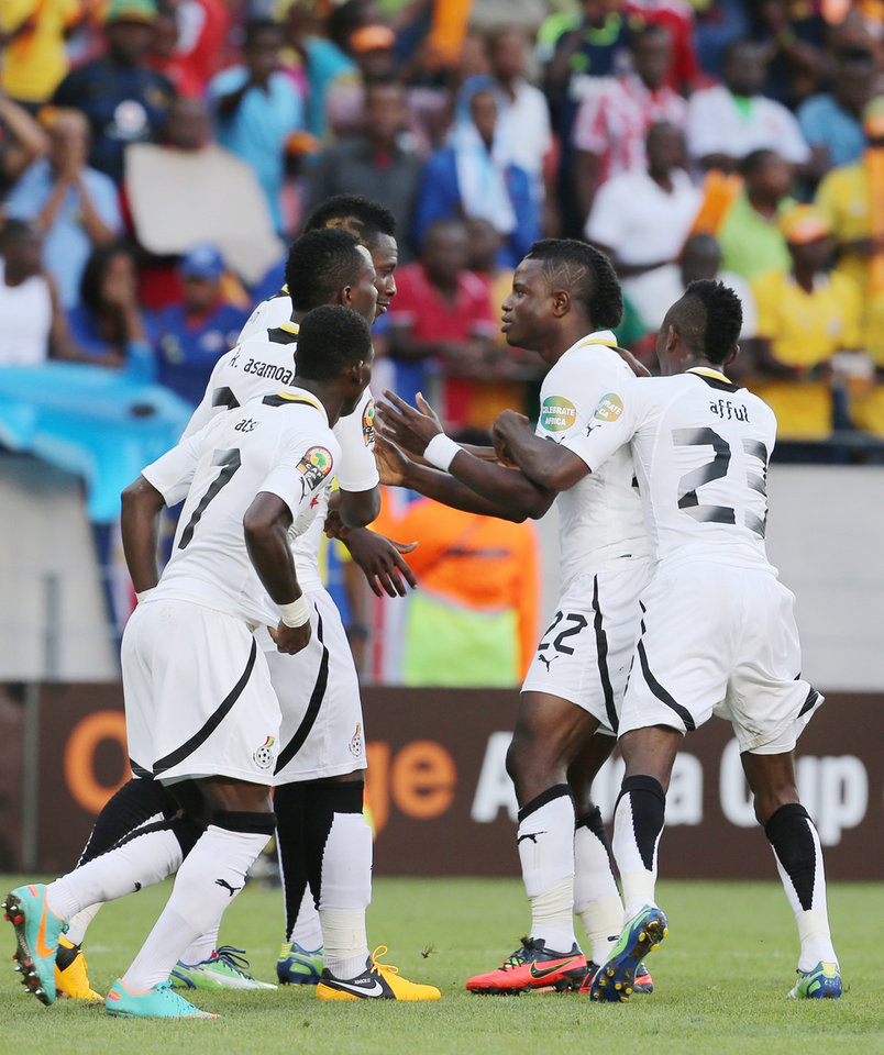 Photo - Ghana's Wakaso Mubarak, second from right, celebrates with teammates after scoring his second goal during their quarter final of the African Cup of Nations  soccer match against Cape Verde at the Nelson Mandela Bay Stadium in Port Elizabeth, South Africa, Saturday Feb. 2, 2013. (AP Photo/Themba Hadebe)