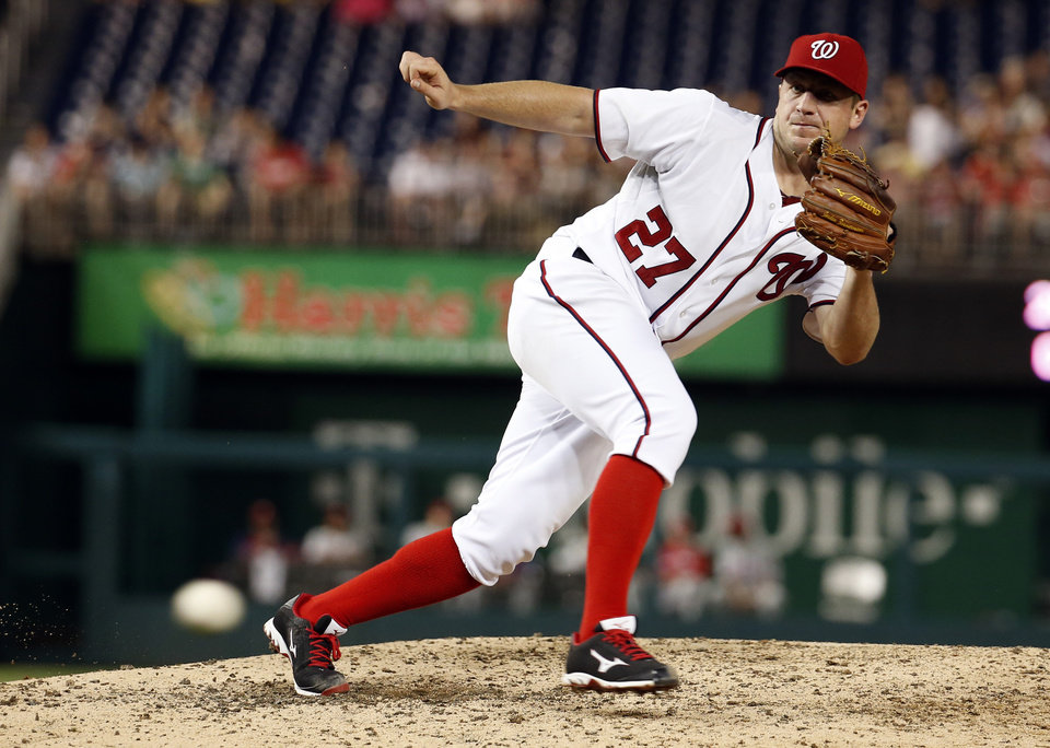 Photo - Washington Nationals starting pitcher Jordan Zimmermann moves to the ball during the eighth inning of a baseball game against the Philadelphia Phillies at Nationals Park Tuesday, June 3, 2014, in Washington. The Nationals won 7-0. (AP Photo/Alex Brandon)