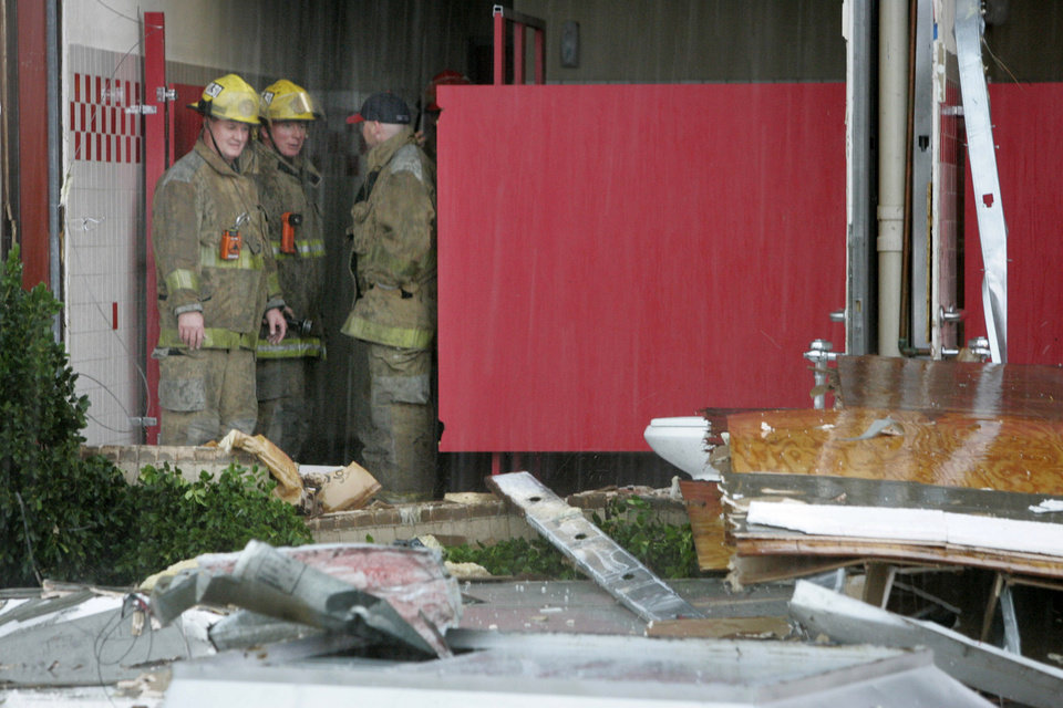 Photo - Oklahoma City firefighters survey damage to a wall at Chuck E Cheese's in Oklahoma City, Oklahoma February 10, 2009.  BY STEVE GOOCH, THE  OKLAHOMAN.