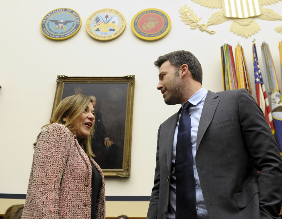 Photo - Ben Affleck, actor and founder of the Eastern Congo Initiative, talks with Rep. Loretta Sanchez, D-Calif., as he arrives to testify before the House Armed Services Committee on the evolving security situation in the Democratic Republic of the Congo during a hearing on Capitol Hill in Washington, Wednesday, Dec. 19, 2012. (AP Photo/Susan Walsh)