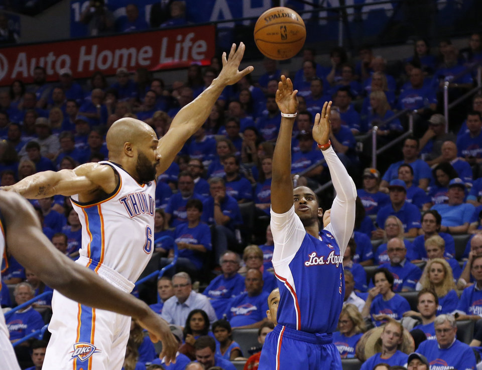 Photo - Los Angeles Clippers guard Chris Paul (3) shoots in front of Oklahoma City Thunder guard Derek Fisher (6) in the second quarter of Game 1 of the Western Conference semifinal NBA basketball playoff series in Oklahoma City, Monday, May 5, 2014. (AP Photo/Sue Ogrocki)