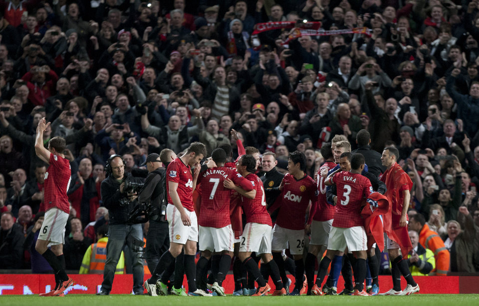 Photo - Manchester United players celebrate as they win their 20th English Premier League title after their 3-0 win over Aston Villa in their soccer match at Old Trafford Stadium, Manchester, England, Monday April 22, 2013. (AP Photo/Jon Super)