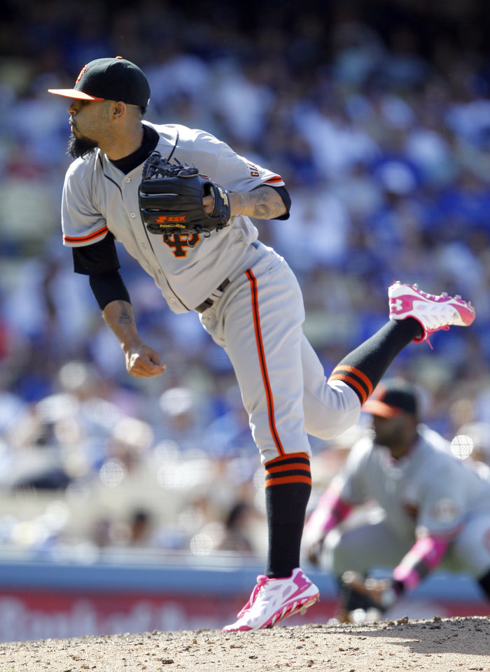 Photo - San Francisco Giants relief pitcher Sergio Romo throws against the Los Angeles Dodgers in the ninth inning of a baseball game on Sunday, May 11, 2014, in Los Angeles. (AP Photo/Alex Gallardo)