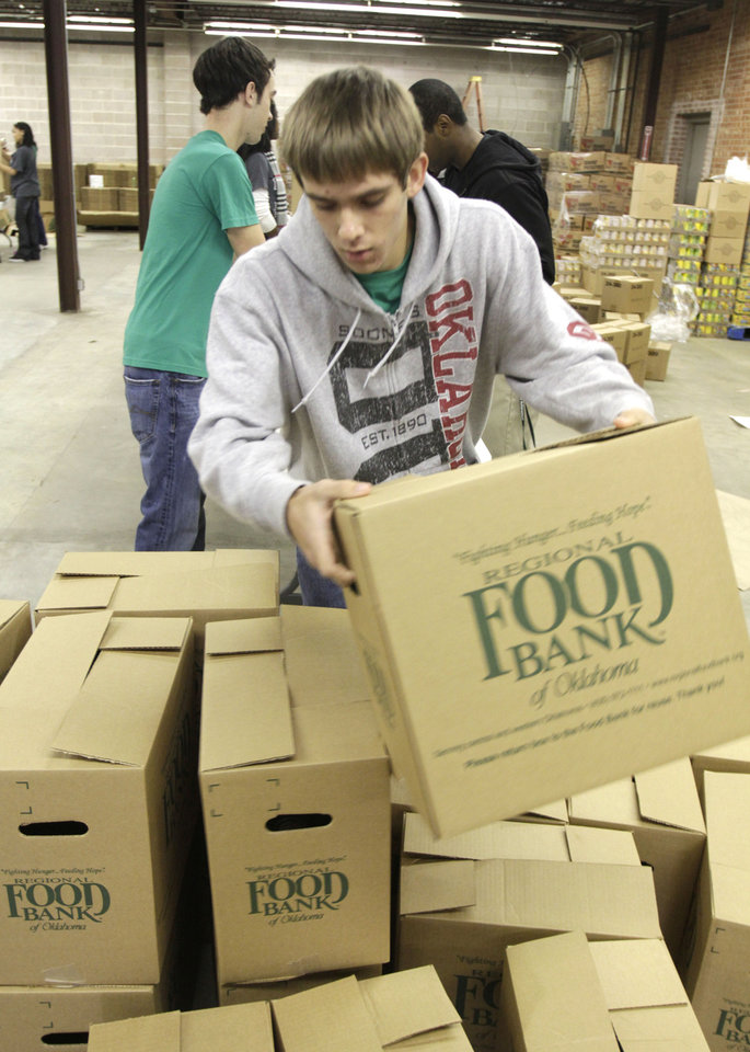 Jeffrey Schmitt stacks full boxes as he and other students from Destiny Christian School volunteer at the City Rescue Mission in Oklahoma City, OK, Monday, Nov. 14, 2011. The Mission is gathering food and donations for its Thanksgiving food delivery. By Paul Hellstern, The Oklahoman