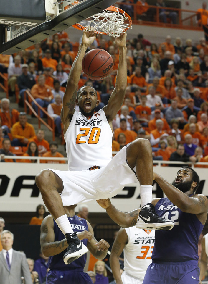 Oklahoma State forward Michael Cobbins (20) dunks in front of Kansas State guard Rodney McGruder, back left, and forward Thomas Gipson (42) in the first half of an NCAA college basketball game in Stillwater, Okla., Saturday, March 9, 2013. (AP Photo/Sue Ogrocki)