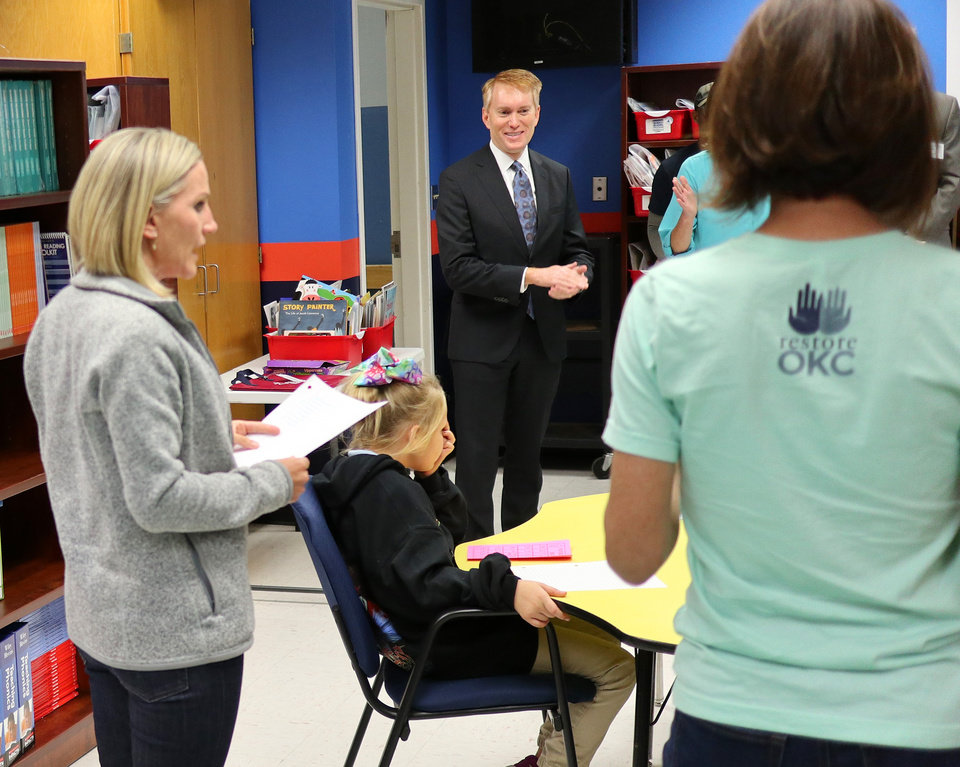 Photo - Sen. James Lankford watches a class in the Russell Westbrook Reading room during a tour of Thelma Parks Elementary School in Oklahoma City looking at the RESTORE OKC program there Tuesday, October 8, 2019. [Doug Hoke/The Oklahoman]