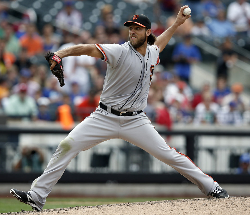 Photo - San Francisco Giants starting pitcher Madison Bumgarner delivers in the ninth-inning of his 9-0, complete-game shutout of the New York Mets in a baseball game, in New York, Sunday, Aug. 3, 2014. (AP Photo/Kathy Willens)