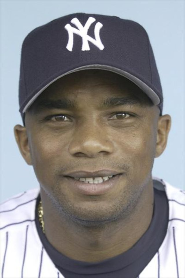 Photo - ORLANDO HERNANDEZ MUG / BASEBALL / PLAYER: ** FILE ** This is a 2002 photo showing Orlando Hernandez. Bartolo Colon moved to the Chicago White Sox, and Orlando Hernandez went to the Montreal Expos on Wednesday Jan. 15, 2003 in a three-team trade also involving the New York Yankees. In exchange for Colon, who won 20 games last season for Cleveland and Montreal, the Expos received Hernandez and another right-hander, Rocky Biddle, plus outfielder Jeff Liefer and cash. The White Sox earlier acquired Hernandez and $2 million from the Yankees for right-handed pitchers Antonio Osuna and Delvis Lantigua, a minor leaguer. (AP Photo/File)