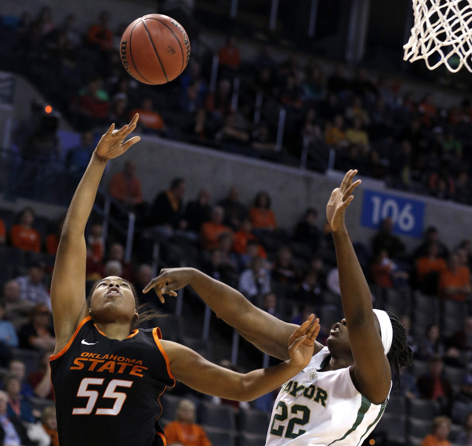 Photo - Oklahoma State's LaShawn Jones (55) shoots as Baylor's Sune Agbuke (22) defends during the Women's Big 12 basketball tournament game between Baylor and Oklahoma State at Chesapeake Energy Arena  in Oklahoma City, Okla., Sunday, March 9, 2014. Photo by Sarah Phipps, The Oklahoman