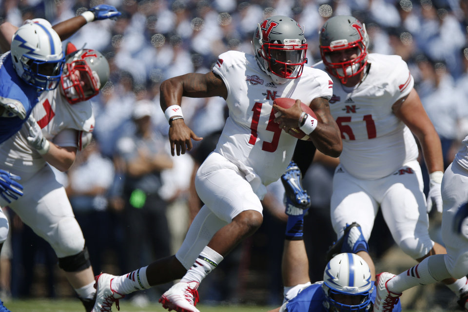 Photo - Nicholls State quarterback Kalen Henderson runs for a short gain against Air Force in the first quarter of an NCAA college football game at Air Force Academy, Colo., on Saturday, Aug. 30, 2014. (AP Photo/David Zalubowski)