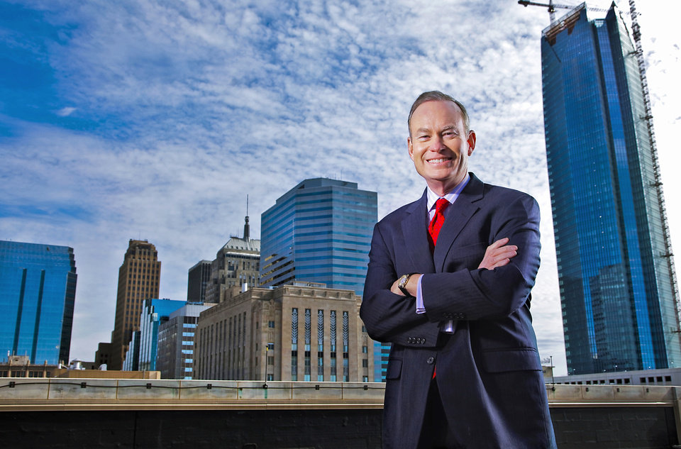 Photo - Oklahoma City Mayor Mick Cornett stands in front of the city skyline on Friday. Cornett is the most visible public face in Oklahoma City, which has a rising international profile.  CHRIS LANDSBERGER - The Oklahoman