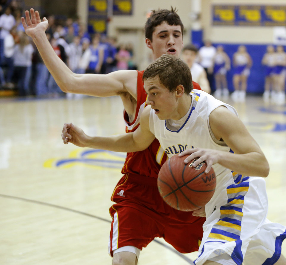 Photo - Bethel's Garret Fitzgerlad drives past Dale's Dustin Stark during their boys high school basketball game at Bethel High School in Shawnee, Okla., Friday, Feb. 1, 2013. Photo by Bryan Terry, The Oklahoman