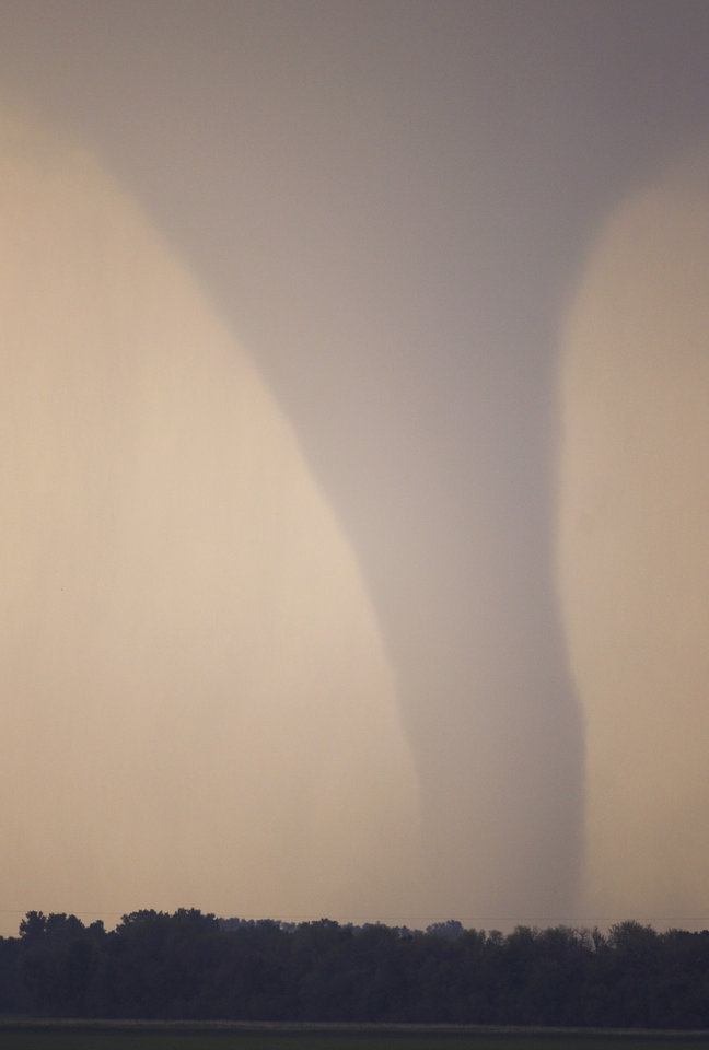 Photo -   A tornado moves on the ground north of Soloman, Kan., Saturday, April 14, 2012. (AP Photo/Orlin Wagner)
