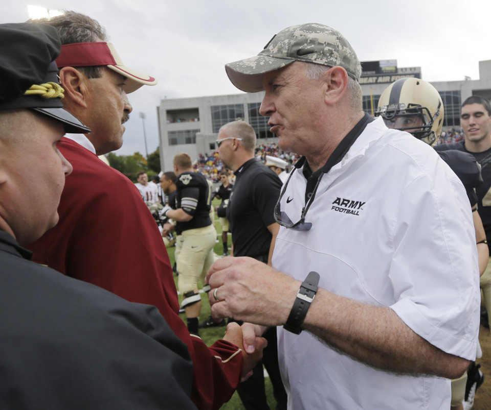 Photo -   Boston College head coach Frank Spaziani, left, and Army head coach Rich Ellerson shake hands after their NCAA college football game Saturday, Oct. 6, 2012, in West Point, N.Y. Army won, 34-31. (AP Photo/Mike Groll)