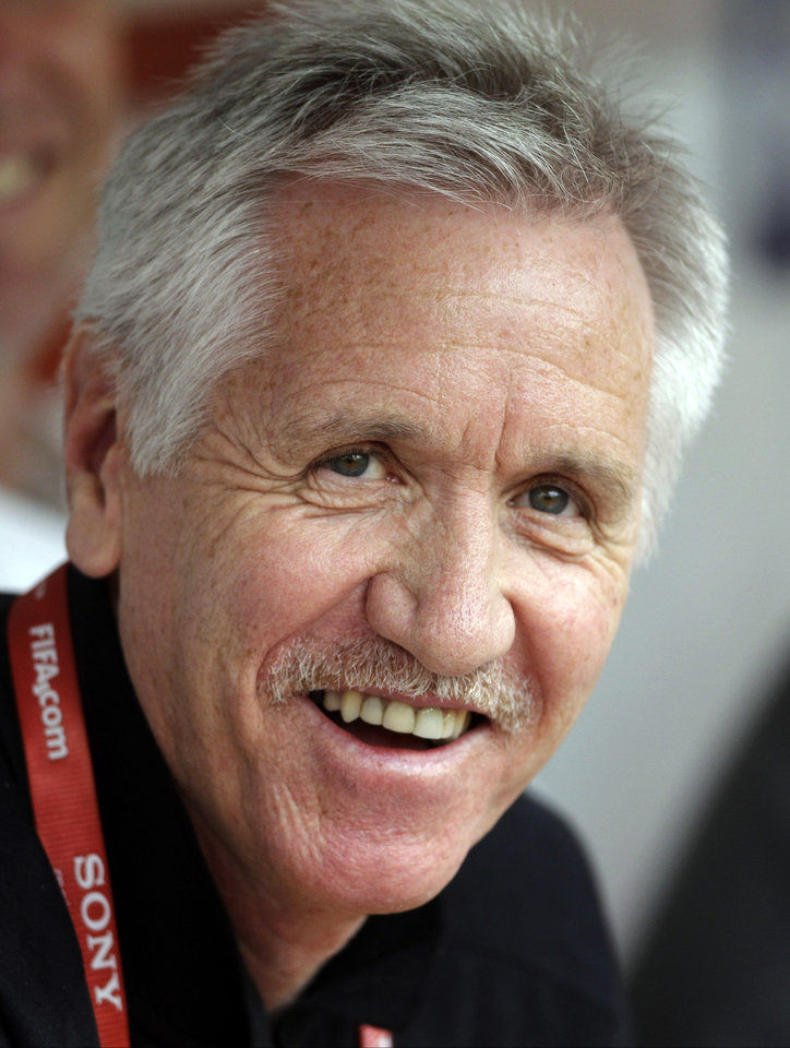 Photo -   FILE - In this July 6, 2011, file photo, Australia head coach Tom Sermanni smiles prior to their group D match against Norway at the Women's Soccer World Cup in Leverkusen, Germany. Sermanni was hired Tuesday, Oct. 30, 2012, to replace Pia Sundhage, who led the United States women's soccer team to back-to-back Olympic gold medals and their first World Cup final in 12 years. Sermanni has spent the last eight years as Australia's coach, taking the Matildas to the quarterfinals of the last two Women's World Cups. (AP Photo/Frank Augstein, File)