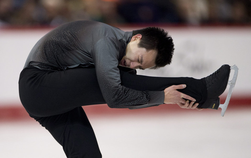 Photo - Patrick Chan performs his routine during the men's short program at the Canadian figure skating championships Friday, Jan. 10, 2014, in Ottawa, Ontario. Chan was in first place following the short program. (AP Photo/The Canadian Press, Adrian Wyld)