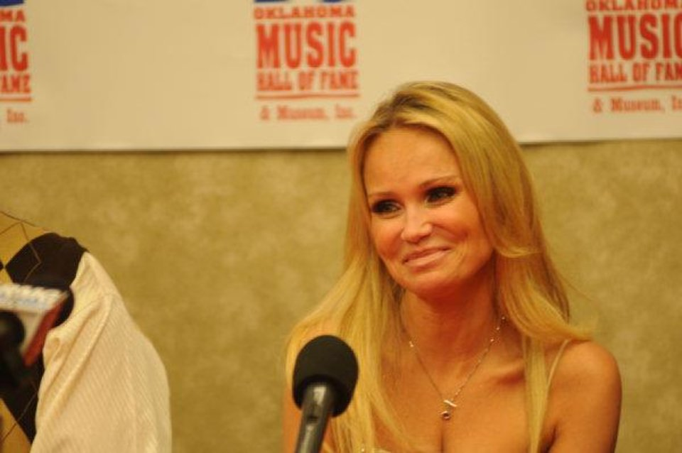 Singer and actress Kristin Chenoweth speaks about being inducted into the Oklahoma Music Hall of Fame on Thursday, Nov. 10, 2011, in Muskogee. Chenoweth is from Broken Arrow and attended Oklahoma City University before moving to New York City and beginning a career in in theater, TV, film and music. Photo by Adam Kemp, For The Oklahoman. <strong></strong>
