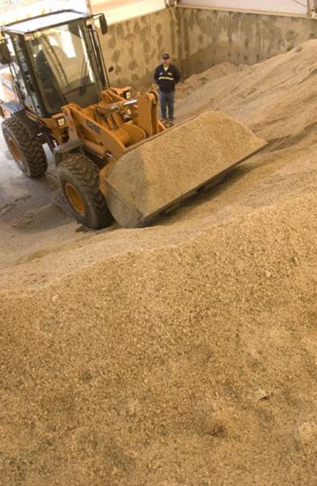 Photo - Workers stockpile salt and sand to use on Oklahoma roadways near Miami, Oklahoma. Photo by Gary Crow.