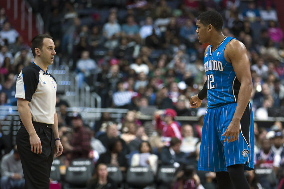 Photo - Orlando Magic forward Tobias Harris, right, argues a call after being called for a technical foul during the second half of an NBA basketball game against the Washington Wizards on Tuesday, Feb. 25, 2014, in Washington. The Wizards defeated the Magic 115-106. (AP Photo/ Evan Vucci)