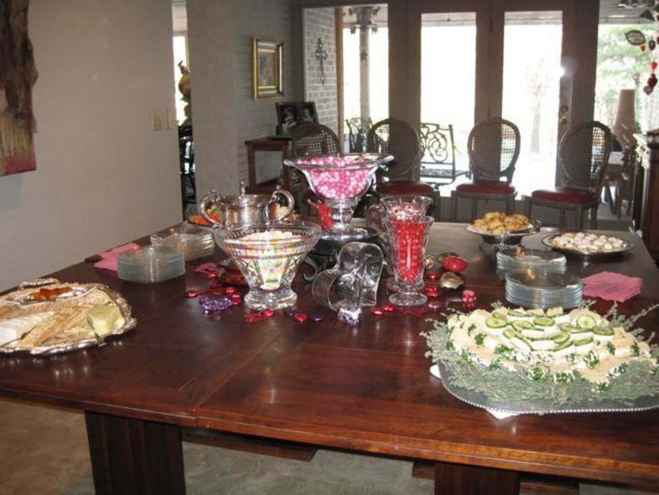 FRIENDS CELEBRATE JANUARY....The table had lots of sandwiches, cookies, cheese and candy. (Photo by Helen Ford Wallace).