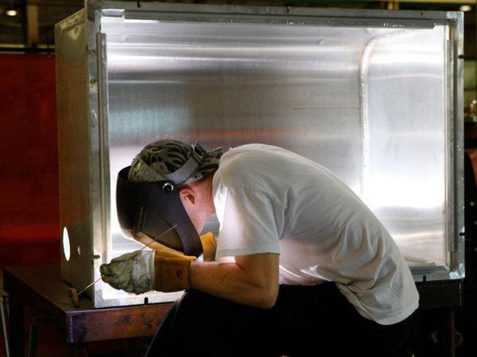 Jeremy Nave welds corners of a T-62 shipping container in a production area  at Choctaw Defense, a growing company owned by the Choctaw Nation that has lucrative contracts with the Department of Defense. It manufactures shipping containers, trailers and other heavy equipment used by the military. Their plant is located in the Choctaw Business Park on the south side of McAlester.   Photos taken Thursday, June 23, 2011   Photo by Jim Beckel, The Oklahoman ORG XMIT: KOD