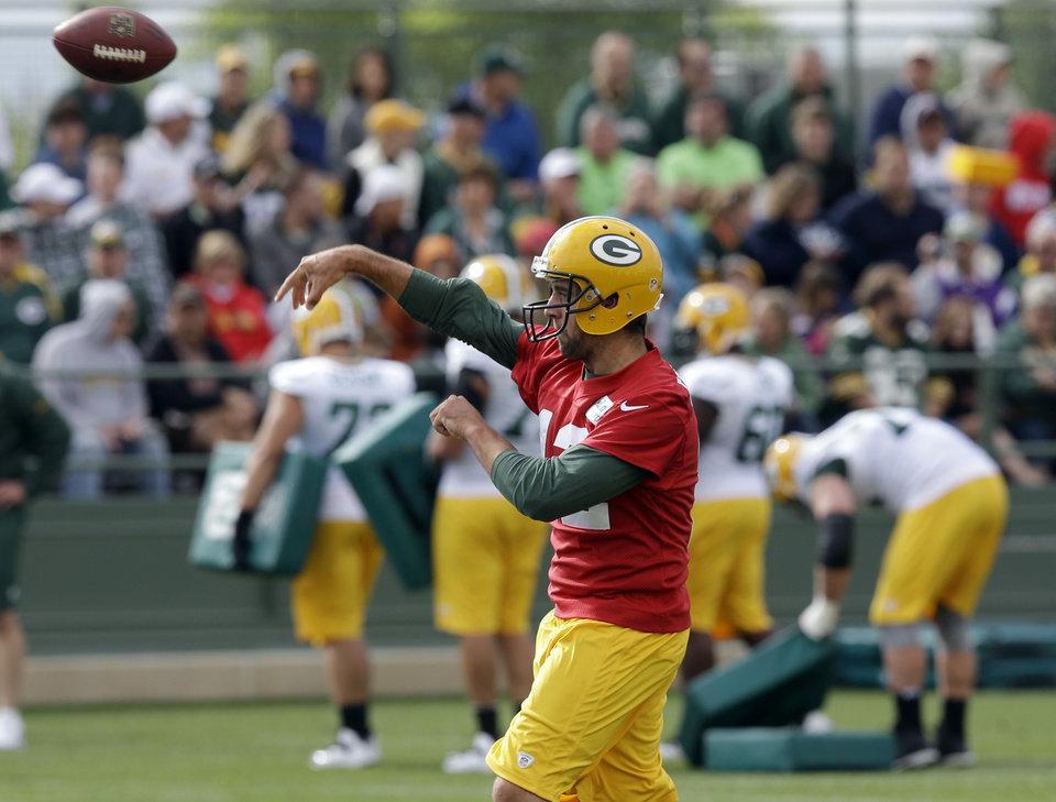 Green Bay Packers' Aaron Rodgers throws a ball during NFL football training camp Saturday, July 27, 2013, in Green Bay, Wis. (AP Photo/Morry Gash)