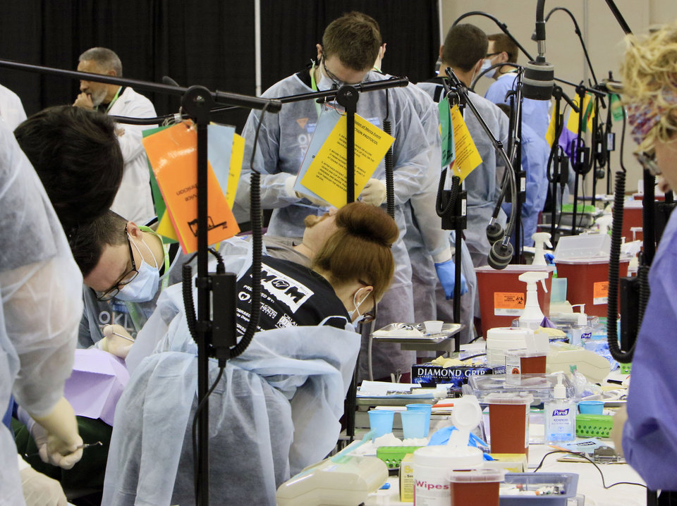Photo -  Hundreds of dentists and dental assistants work on patients during a Oklahoma Mission of Mercy event. [OKLAHOMAN ARCHIVES PHOTO]
