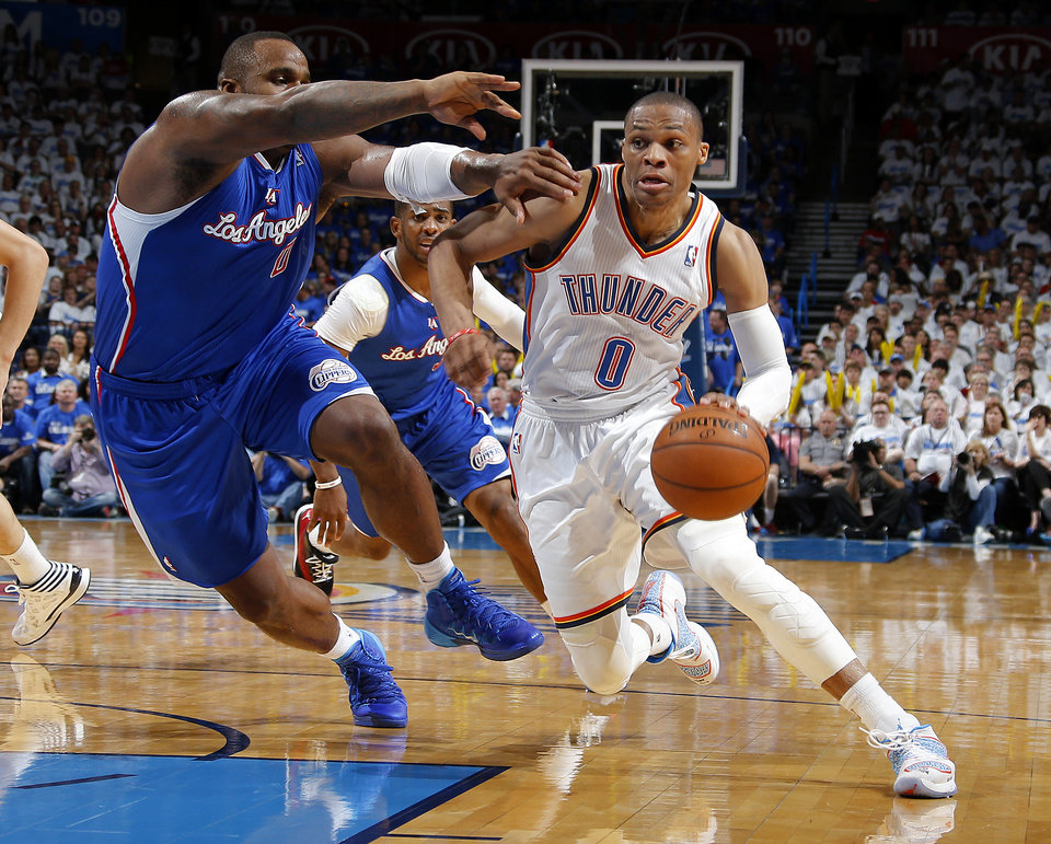 Photo - Oklahoma City's Russell Westbrook (0) goes past Los Angeles' Glen Davis (0) during Game 2 of the Western Conference semifinals in the NBA playoffs between the Oklahoma City Thunder and the Los Angeles Clippers at Chesapeake Energy Arena in Oklahoma City, Wednesday, May 7, 2014. Photo by Bryan Terry, The Oklahoman