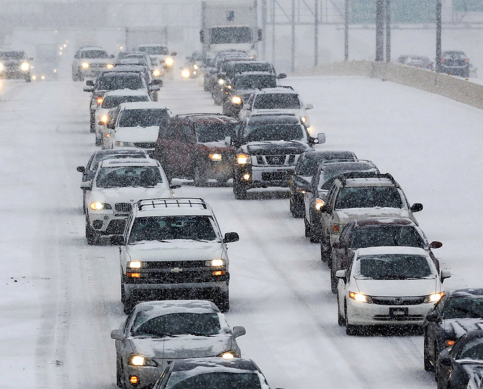 Traffic on the Broadway Extension in north Oklahoma City  is slowed due to snow and sleet brought  by a winter weather system  that moved across the state Thursday, Dec. 5, 2013. (AP Photo / Jim Beckel, The Oklahoman)