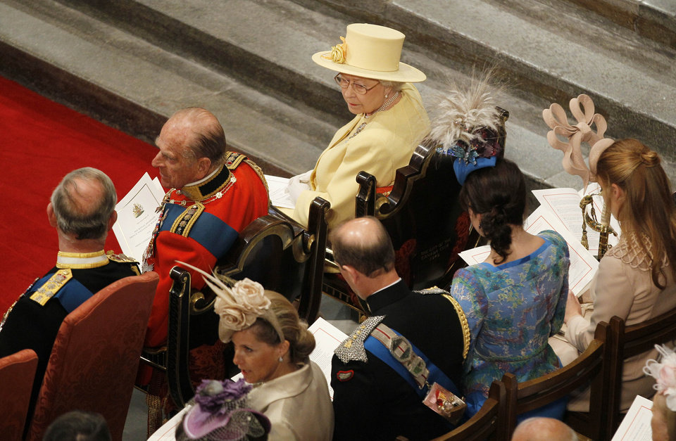 Photo - Britain's Prince Charles, Prince Philip, Queen Elizabeth II, left row, from left, and, right row, Sophie Rhys-Jones, Countess of Wessex , Prince Andrew, Princess Eugenie and Princess Beatrice attend the wedding service at Westminster Abbey at the Royal Wedding in London Friday, April, 29, 2011. (AP Photo/Kirsty Wigglesworth, pool)  ORG XMIT: RWFO164