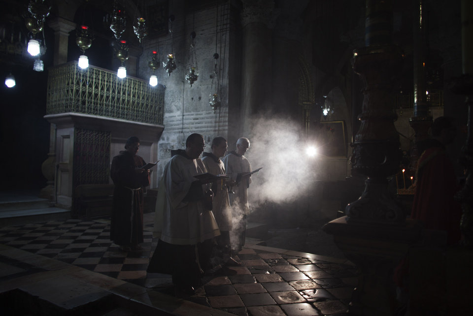 Photo - File - In this Monday, May 14, 2012 file photo, Catholic priests burn incense as they perform a liturgy outside the the Tomb of Jesus in the Church of the Holy Sepulcher in Jerusalem. Pope Francis and the spiritual leader of the world's Orthodox Christians could not have chosen a more fitting meeting place to promote Christian unity on Sunday than the Jerusalem holy site where their churches' centuries-old rivalries and machinations play out every day. The Church of the Holy Sepulcher, where the pope will meet Ecumenical Patriarch Bartholomew I in the central event of his Holy Land trip, marks the spot where Roman Catholic and Orthodox Christians believe Jesus was crucified, buried and resurrected. (AP Photo/Dusan Vranic, File)