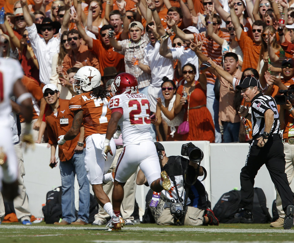 UT's Marcus Johnson (7) scores a touchdown in front of OU's Kass Everett (23) during the Red River Rivalry college football game between the University of Oklahoma Sooners and the University of Texas Longhorns at the Cotton Bowl Stadium in Dallas, Saturday, Oct. 12, 2013. Texas won 36-20. Photo by Bryan Terry, The Oklahoman