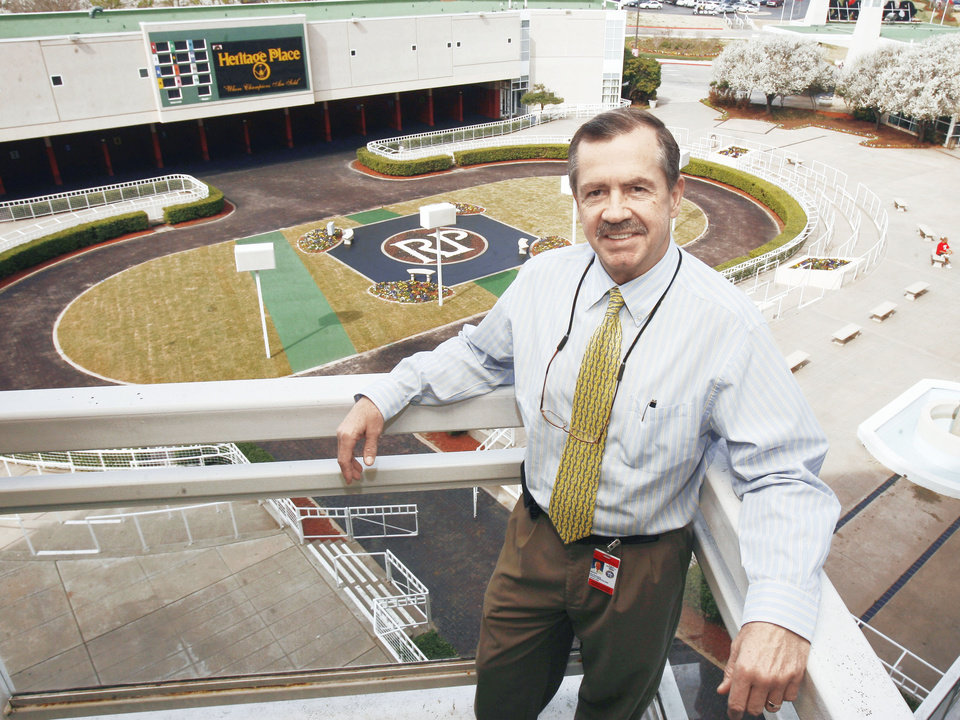 Photo - Remington Park President and General Manager Scott Wells stands on a balcony above the paddock area at Remington Park on  Friday.  Photo BY PAUL HELLSTERN, THE OKLAHOMAN