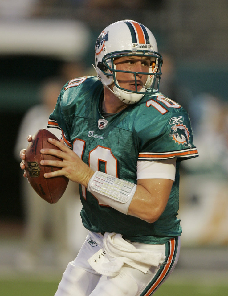 Photo - NFL FOOTBALL: ** FILE ** In this Aug. 23, 2008 file photo, Miami Dolphins quarterback Chad Pennington drops back to pass during the first quarter of a preseason football game against the Kansas City Chiefs at Dolphin Stadium in Miami. Pennington, who became expendable in New York when the Jets acquired Brett Favre, will face his former team and the quarterback who replaced him in the season opener Sunday. (AP Photo/Alan Diaz, File) ORG XMIT: NY166