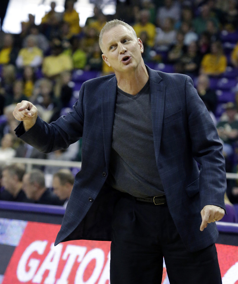 Photo - TCU head coach Jeff Mittie  gestures from the sideline during the first half of an NCAA college basketball game against the Baylor Saturday, Feb. 22, 2014, in Fort Worth, Texas. (AP Photo/LM Otero)
