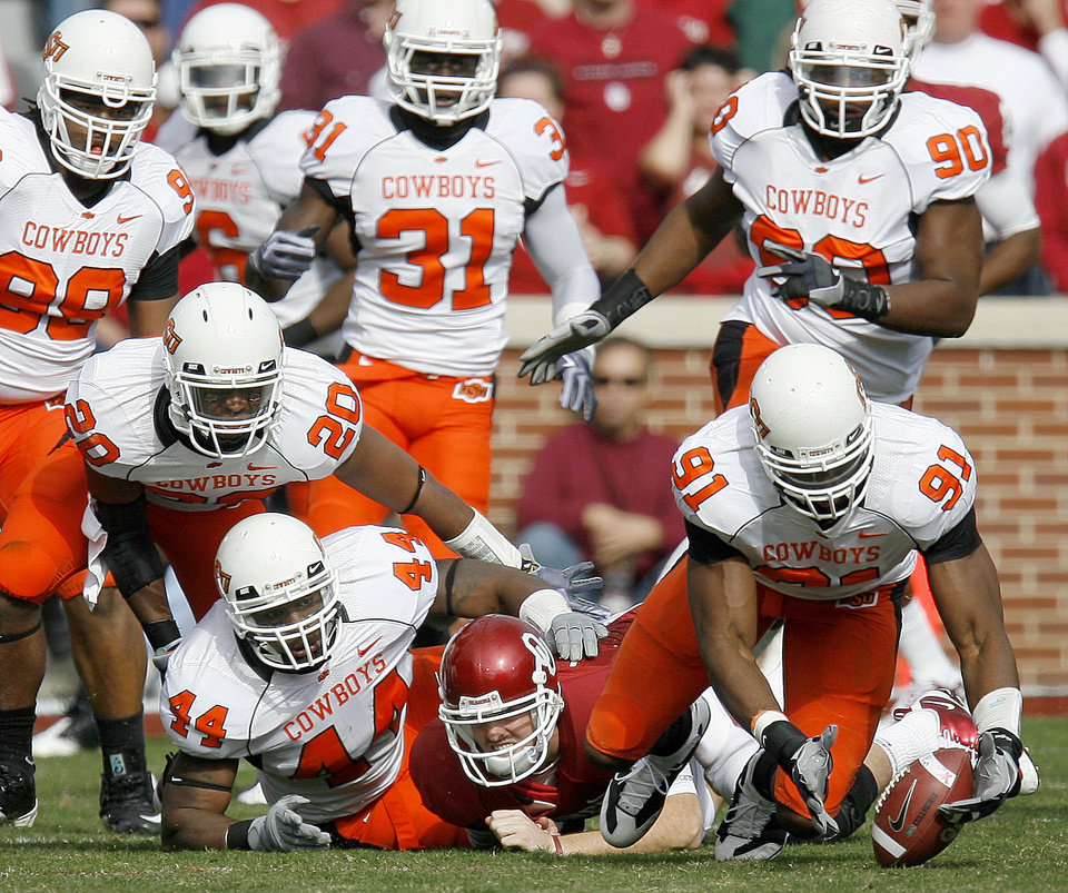 Photo - OSU's Ugo Chinasa recovers a Landy Jones fumble during the first half of the Bedlam college football game between the University of Oklahoma Sooners (OU) and the Oklahoma State University Cowboys (OSU) at the Gaylord Family-Oklahoma Memorial Stadium on Saturday, Nov. 28, 2009, in Norman, Okla.
