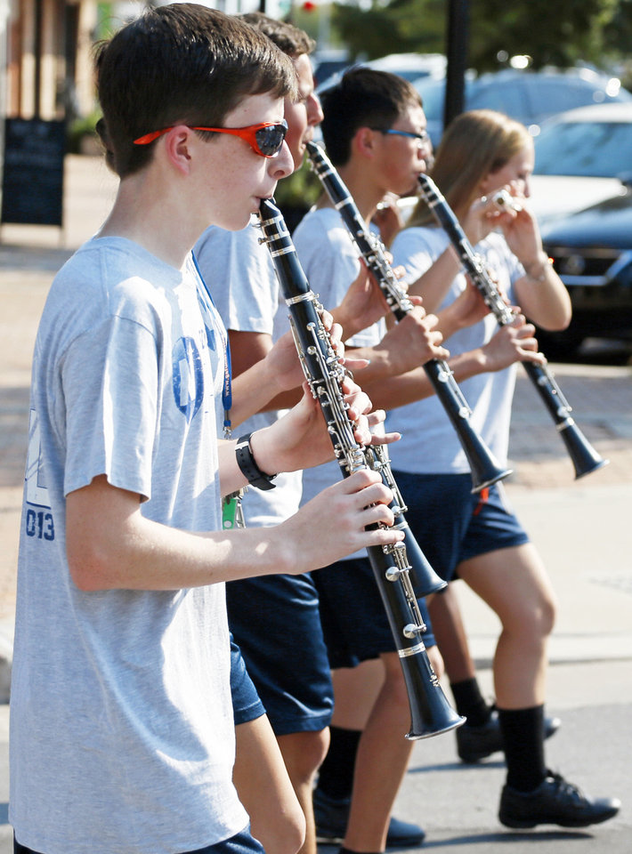 Photo - Clarinet players march Thursday with the Edmond North band during the homecoming parade. Photo by Nate Billings, The Oklahoman