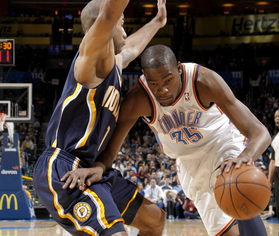 Photo - Oklahoma City's Kevin Durant (35) drives around Indiana's Dahntay Jones (1)  during the NBA basketball game between the Oklahoma City Thunder and the Indiana Pacers at the Oklahoma City Arena, Wednesday, March 2, 2011. Photo by Bryan Terry, The Oklahoman