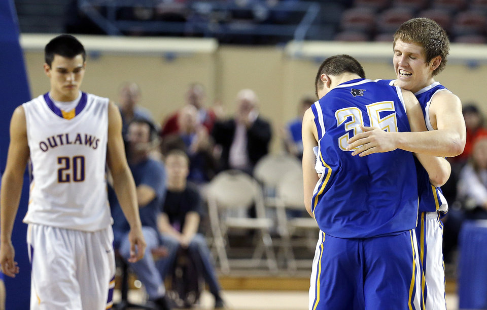 Glencoe's Hunter Hall and Ty Lazenby (35) celebrate their Class A boys state championship in front of Weleetka's Jeremiah Winney at the State Fair Arena.,  Saturday, March 2, 2013. Photo by Sarah Phipps, The Oklahoman