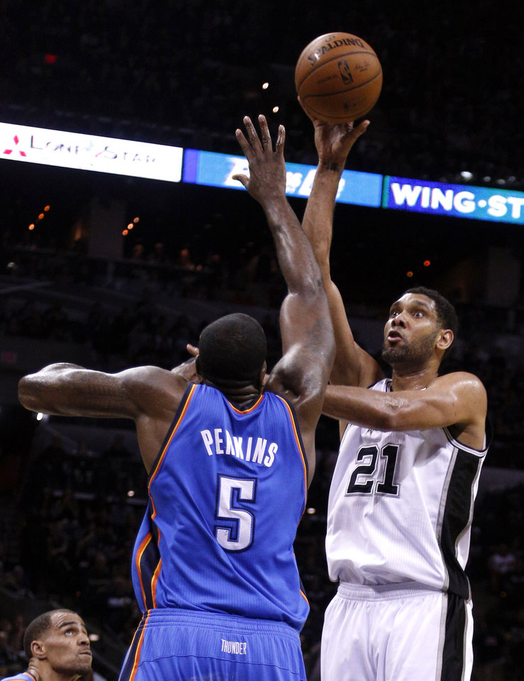 Photo - Oklahoma City's Andre Roberson (21) shoots over Oklahoma City's Kendrick Perkins (5) during Game 1 of the Western Conference Finals in the NBA playoffs between the Oklahoma City Thunder and the San Antonio Spurs at the AT&T Center in San Antonio, Monday, May 19, 2014. Photo by Sarah Phipps, The Oklahoman