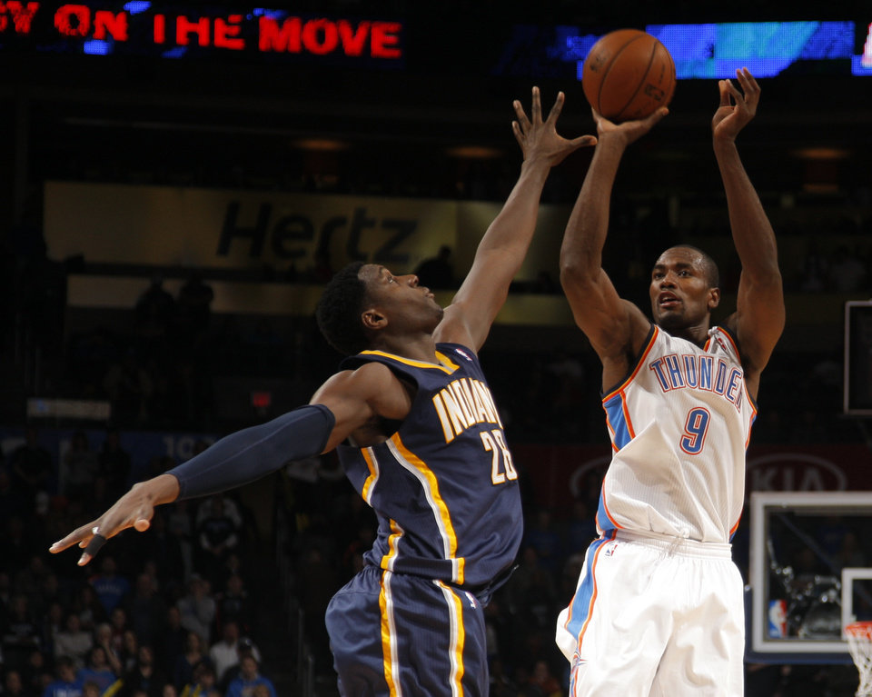Oklahoma City\'s Serge Ibaka (9) shoots over Indiana\'s Ian Mahinmi (28) during the NBA game between the Indiana Pacers and the Oklahoma City Thunder at the Chesapeake Energy Arena Sunday,Dec. 9, 2012. Photo by Sarah Phipps, The Oklahoman